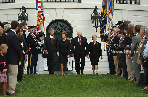 Washington, D.C. - September 11, 2004 --  United States President George W. Bush, first lady Laura Bush, United States Vice President Dick Cheney, and Lynne Cheney walk past an honor guard as they observe a moment of silence marking 3 years from the moment of the first terrorist attack on the World Trade Center in New York on September 11, 2001.<br /> Credit: Ron Sachs / CNP