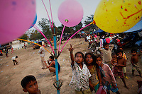 Cambodian children, displaced because of fighting near their villages, react to the colorful balloons offered for sale at their temporarily shelter at a Buddhist pagoda near the 11th-century Preah Vihear temple at the border between Thailand and Cambodia February 9, 2011. Thailand and Cambodia faced growing diplomatic pressure on Wednesday to end an armed standoff on a stretch of border surrounding a 900-year-old clifftop temple as guns held silent for a second day.    REUTERS/Damir Sagolj (CAMBODIA)