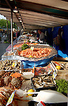 Fish stall offering a variety of sea foods at the market in Bastille, Paris,France.