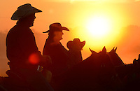 Gary Cosby Jr./Decatur Daily   Worshippers join together for a sunrise service at the No Fences Cowboy Church Easter Sunday morning in Falkville.  Cowboys on horseback greet the sunrise and arriving worshippers.