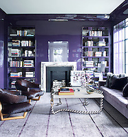 The purple lacquered walls of the library literally shimmer in the suffused daylight through the apartment's large windows