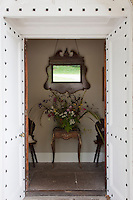 Studded double doors open into a narrow corridor at the entrance to Lisnavagh House