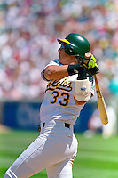 OAKLAND, CA - Jose Canseco of the Oakland Athletics bats during a game at the Oakland Coliseum in Oakland, California in 1991. Photo by Brad Mangin