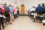 Larry Klein speaks to a crowd at the memorial service for Sun City resident Monte Haag, who moved to Sun City in 2000 and died in December 2010. He died in a crash flying an ultralight plane outside of Sun City. The service was held in Social Hall No. 1 of the Bell Recreation Center in Sun City, Arizona December 11, 2010...2010 marks the 50th anniversary of Sun City, America's first retirement city that remains the largest today with more than 40,000 residents 55 and older.