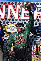 TOPEKA, KS - JUNE 1: John Force celebrates his victory in the Funny Car class on June 1, 2008, in the OReilly NHRA Summer Nationals at Heartland Park Topeka near Topeka, Kansas.