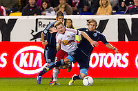 Dax McCarty (11) of the New York Red Bulls is fouled by Chance Myers (7) of Sporting Kansas City. The New York Red Bulls and Sporting Kansas City played to a 0-0 tie during a Major League Soccer (MLS) match at Red Bull Arena in Harrison, NJ, on October 20, 2012.