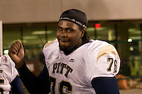 Pitt offensive lineman Jeff Otah celebrates the Pitt Panthers upset over the West Virginia Mountaineers 13-9 on December 01, 2007 in the 100th edition of the Backyard Brawl at Mountaineer Field, Morgantown, West Virginia.