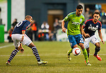 Seattle Sounders Lamar Neagle (27) New England Revolution Teal Bunbury (10) during an MLS match on March 8, 2015 in Seattle, Washington.  The Sounders beat the Revolution 3-0.  Jim Bryant Photo. ©2015. All Rights Reserved.