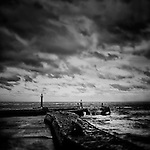 The lIghthouses of Whitby Pier in harsh Winds and choppy seas