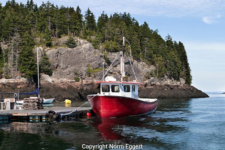 Red Fishing Boat moored to a dock in Head Harbor, Campobello Island, New Brunswick, Canada