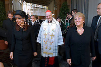 Cardinal Comastri;Chilean President Michelle Bachelet Jeria (R) and Argentine President Cristina Fernandez de Kirchnerat (L) exchange gifts with Pope Benedict XVI (C) during their private audience at the Vatican on November 28, 2009.