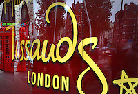 Yellow Tussauds' signature on panels reflecting the street Marylebone Road, London, UK. Picture by Manuel Cohen