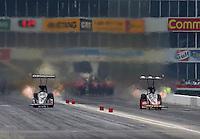 Apr 26, 2015; Baytown, TX, USA; NHRA top fuel driver Larry Dixon (left) races alongside Doug Kalitta during the Spring Nationals at Royal Purple Raceway. Mandatory Credit: Mark J. Rebilas-