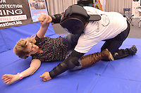 Pamela Henkels and Instructor Erick Hill of Basic Instincts demonstrates self protection techniques at the Santa Monica Civic Auditorium during Shecky's Girls Night Out on Tuesday, May 1, 2012 .