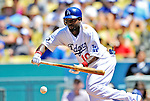 24 July 2011: Los Angeles Dodgers outfielder Tony Gwynn lays down a bunt during a game against the Washington Nationals at Dodger Stadium in Los Angeles, California. The Dodgers defeated the Nationals 3-1 to take the rubber match of their three game series. Mandatory Credit: Ed Wolfstein Photo
