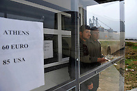 Immigrants buy tickets for a bus to take them to Athens, after they were released from the detention centre in Fylakio. According to UNHCR, 38,992 immigrants arrived in Greece in the first 10 months of 2010, whereas in 2009 the number was only 7,574. A poster in the window shows prices to travel to Athens.
