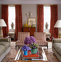 Vases of Hyacinths and Aliums on the coffee table create a focal point in the living room