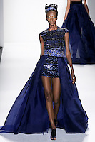 Model walks runway an BEADED &lsquo;ONE THOUSAND NIGHTS &amp; ONE NIGHT&quot; IMPERIAL BALL GOWN by Zang Toi, for the Zang Toi Spring 2012 My Dream Of North Africa Collection, during Mercedes-Benz Fashion Week Spring 2012.