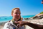 A woman receiving an ocher blessing at Raft Point, Kimberley Coast, Australia