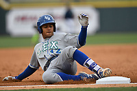 Second baseman Gabriel Cancel (12) of the Lexington Legends slides into third base in a game against the Columbia Fireflies on Sunday, April 23, 2017, at Spirit Communications Park in Columbia, South Carolina. Lexington won, 4-2. (Tom Priddy/Four Seam Images)