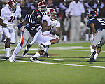 Alabama wide receiver Marquis Maze (4) runs and is tackled by Ole Miss' Serderius Bryant (14) at Vaught-Hemingway Stadium in Oxford, Miss. on Saturday, October 14, 2011. Alabama won 52-7.