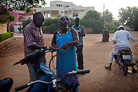 Yvette explains, early in the morning to a dissatisfied costumer, why he did not win this time . The same bettor complains about cheating rumors within the LONAB ( National Lottery of Burkina).