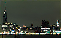 13 September 2001: View of the Empire State Building and mid-town two nights after the Terrorist attack on the America's.  Lower Manhattan, NY. Area surrounding ground zero where the World Trade Centers WTC once stood only hours after they fell to the ground in New York.  Islamic terrorist Osama bin Laden declares The Jihad or Holy War against The United States of America on September 11, 2001. Headline news photos available for editorial use.