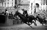 &copy; Francesco Cito / Panos Pictures..Siena, Tuscany, Italy. The Palio. ..Twice each summer, the Piazza del Campo in the medieval Tuscan town of Siena is transformed into a dirt racetrack for Il Palio, the most passionately contested horse race in the world. The race, which lasts just 90 seconds, has become intrinsic to the town's heritage since it was first run in 1597.