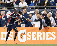 New England Revolution forward Saer Sene (39) celebrates his second goal of the game with New England Revolution coach Jay Heaps. In a Major League Soccer (MLS) match, the New England Revolution tied Chivas USA, 3-3, at Gillette Stadium on August 29, 2012.