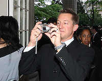 Doug Hicks of DC United takes aim at a reception for AC Milan at DAR Constitution Hall in Washington DC on May 24 2010.