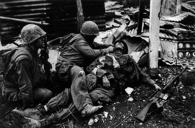 U.S. Marines treating a wounded comrade, Têt offensive, Battle of Hué, Vietnam, February 1968