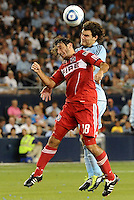 Gaston Puerari (18) Chicago Fire, Graham Zusi Sporting KC...Sporting KC were held to a scoreless tie with Chicago Fire in the inauguarl game at LIVESTRONG Sporting Park, Kansas City, Kansas.