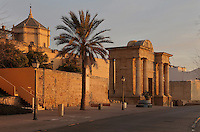 Puerta del Puente, or Gate of the Bridge, built in Renaissance style with Doric columns and classical entablature by Hernan Ruiz III in 1572 to link the city to the Roman bridge, in Cordoba, Andalusia, Southern Spain. On the left is the Great Mosque of Cordoba, now part of the Cathedral. The first church built here by the Visigoths in the 7th century was split in half by the Moors, becoming half church, half mosque. In 784, the Great Mosque of Cordoba was built in its place, but in 1236 it was converted into a catholic church, with a Renaissance cathedral nave built in the 16th century. The historic centre of Cordoba is listed as a UNESCO World Heritage Site. Picture by Manuel Cohen