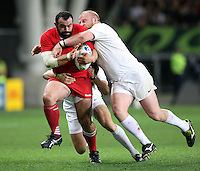 Georgia's David Zirakashvili, left, in the tackle of England's Dan Cole in the Rugby World Cup pool match at Otago Stadium, Dunedin, New Zealand, Sunday, September 18, 2011. Credit:SNPA / Dianne Manson.