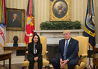American charity worker Aya Hijazi, 30, who was imprisoned in Cairo for three years, meets with United States President Donald J. Trump at the Oval Office in the White House in Washington, D.C. on April 21, 2017. <br /> Credit: Gabriella Demczuk / Pool via CNP /MediaPunch