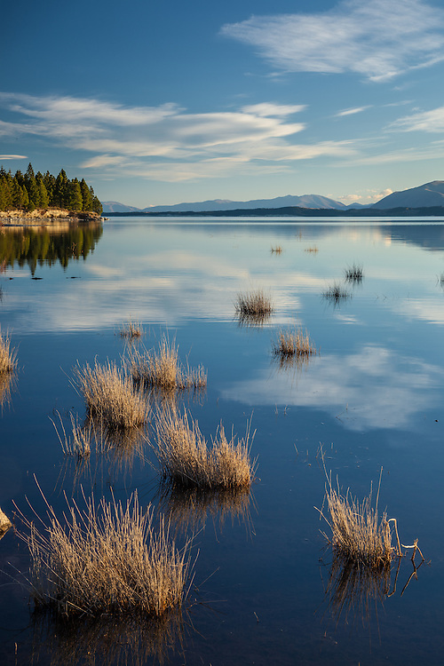 Clouds reflected in the waters of Lake Pukaki, Mackenzie Basin South Island, New Zealand - stock photo, canvas, fine art print