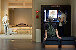 Visitors look at a touch-panel display while another looks at one of the zashiki Japanese-style rooms at the Saitama Omiya Bonsai Museum of Art in Saitama, Japan on 15 Aug. 2011..Photographer: Robert Gilhooly