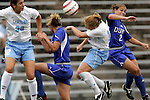 09 October 2005: Duke and North Carolina players battle for a ball in midfield.  Players include North Carolina's Yael Averbuch (32) and Lori Chalupny (17) and Duke's Carmen Bognanno (2). The Duke Blue Devils defeated the #1 ranked Carolina Tar Heels 2-1 at Fetzer Field in Chapel Hill, North Carolina in a regular season Atlantic Coast Conference women's soccer game.