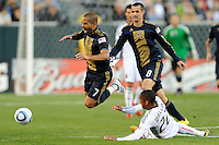 Fred (7) of the Philadelphia Union is fouled by Rodney Wallace (22) of D. C. United during a Major League Soccer (MLS) match at Lincoln Financial Field in Philadelphia, PA, on April 10, 2010.