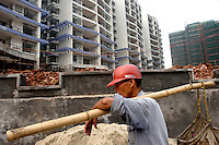 A labourer at work on a construction site in Guangzhou, southern China. China's construction boom continues, with demand for materials exhausting much of China's resources.