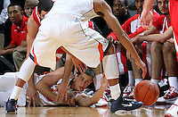 Dec. 07, 2010; Charlottesville, VA, USA;  Virginia Cavaliers guard Sammy Zeglinski (13) reaches for the loose ball between the legs of teammate Virginia Cavaliers guard Mustapha Farrakhan (2) during the game against the Radford Highlanders at the John Paul Jones Arena. Virginia won 54-44. Mandatory Credit: Andrew Shurtleff