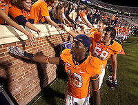 Oct 23, 2010; Charlottesville, VA, USA;  Virginia Cavaliers wide receiver Kris Burd (18) and Virginia Cavaliers offensive tackle Nick Koutris (69) greets the fans after the 48-21 victory over the Eastern Michigan Eagles at Scott Stadium. Mandatory Credit: Andrew Shurtleff