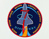 The STS-95 patch, designed by the crew, is intended to reflect the scientific, engineering, and historic elements of the mission. The Space Shuttle Discovery is shown rising over the sunlit Earth limb, representing the global benefits of the mission science and the solar science objectives of the Spartan Satellite. The bold number '7' signifies the seven members of Discovery's crew and also represents a historical link to the original seven Mercury astronauts. The STS-95 crew member John Glenn's first orbital flight is represnted by the Friendship 7 capsule. The rocket plumes symbolize the three major fields of science represented by the mission payloads: microgravity material science, medical research for humans on Earth and in space, and astronomy. The NASA insignia design for Space Shuttle flights is reserved for use by the astronauts and for other official use as the NASA Administrator may authorize. Public availability has been approved only in the form of illustrations by the various news media. When and if there is any change in this policy, which we do not anticipate, it will be publicly announce.Credit: NASA via CNP