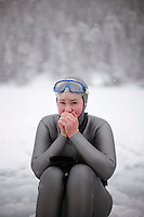 Elisabeth Kristoffersen (Norway) warming her hands after a dive. Freediving competition Oslo Ice Challenge at freshwater lake Lutvann outside the Norwegian capital Oslo. Atheletes, including current and former world champions, entered a hole in the ice to compete. The participants reached depths down to 52 meters below the surface.