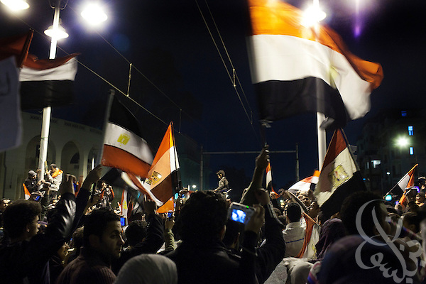 Egyptians in the district of Heliopolis react to news that Egyptian President Hosni Mubarak had stepped down February 11, 2011 following momentous marches on the public buildings across Cairo, Egypt. (Photo by Scott Nelson)