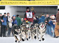 OFF AND RUNNING... Defending Yukon Quest champion Lance Mackey bolts out of the start chute in Fairbanks on Saturday.