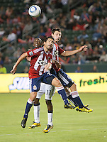 Chivas midfielder Michael Nagamura (26) and Revolution midfielder Kheli Dube (11) go up to head ball during the first half of the game between Chivas USA and the New England Revolution at the Home Depot Center in Carson, CA, on September 10, 2010. Chivas USA 2, New England Revolution 0.