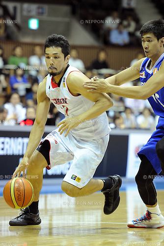 Shohei Kikuchi (JPN), Mark Anthony Borboran (PHI),<br /> JUNE 30, 2013 - Basketball :<br /> Reconstruction support of the Great East Japan Earthquake, International friendly match between Japan men's national team 88-61 Philippines men's national team at Yoyogo 2nd Gymnasium in Tokyo, Japan. (Photo by AZUL/AFLO)