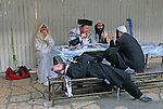 Men sit together at the grave compound of Rashbi (Rabbi Shimon Bar Yochay) in Meron Mt. in north Israel. Rashbi is the author of &quot;Zohar&quot; book, the primary book of the Kabbalah stream.<br />