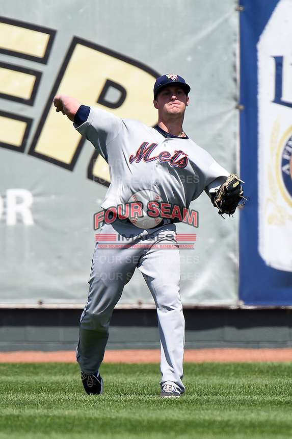 Binghamton Mets outfielder Kyle Johnson (1) throws the ball in during a game against the Erie Seawolves on July 13, 2014 at Jerry Uht Park in Erie, Pennsylvania.  Binghamton defeated Erie 5-4.  (Mike Janes/Four Seam Images)